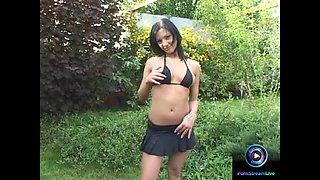 Destiny as she plays with her dildo outdoors