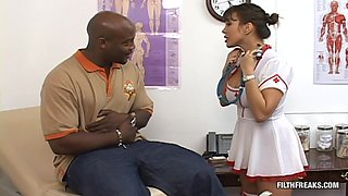 Nurse takes care of a big black cock in couple of different positions