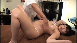 Petite Asian girl enjoys a hard fucking on the massage table