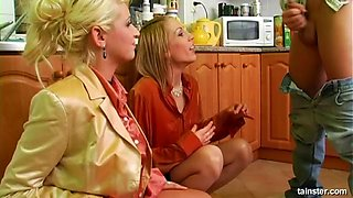Experienced blonde and her best friend ride the dick in the kitchen