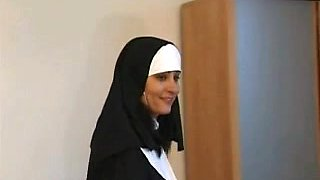 A nun gives some spanking to a naughty blonde