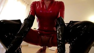 Slut In Red Latex Cat Suit Black Boots Fucks Slave