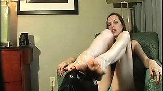Dominant brunette milf has a masked slave licking her toes