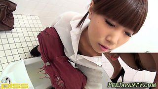 Asian teen pissing in public toilet