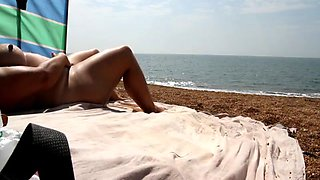 Wife plays with her pussy at the beach