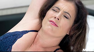 Sleepy milf Montse Swinger masturbates on her bed with a dildo