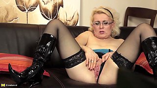 Janka M is a blonde with glasses who loves playing with a dildo