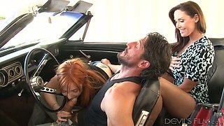 Skilled brunette MILF watched naughty redhead sucking big cock of her guy in car