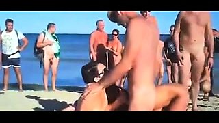 Lustful amateur swingers indulge in group sex on the beach