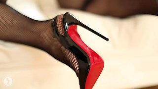 Hot girl in louboutin heels and fishnet bodystocking