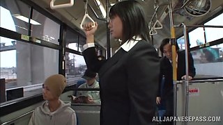 A Japanese office chick with big boobs gets banged in a bus