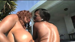 Two ebony beauties fuck in the pool