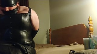 wakeing up in leather and bondage crossdresser
