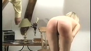 Bare golden-haired caning