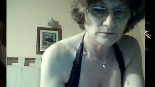 Mature lady still has seductive cleavage and big tits