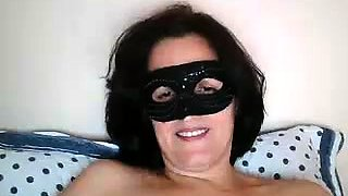 Masked brunette milf has fun with sex toys on the webcam