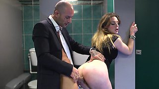 Bald man in suit fucks swanky chick's anus in the restroom