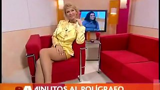 Italian diva in a short yellow dress shows off her long legs