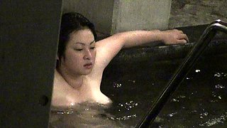 Alluring Oriental girl puts her big natural boobs on display