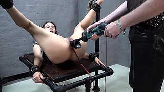 Slave girl gets fucked by a machine