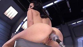 Brunette takes huge dildo machine