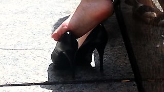 Street voyeur captures a sexy amateur babe with lovely feet