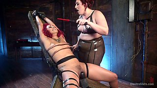 BBW mistress punishes pussy of slim girl Daisy Ducati in the dark bdsm room