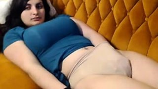 Big breasted brunette camgirl gets naked and masturbates
