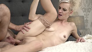 Young guy treats shaved vagina of old blonde with hard penis