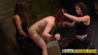 Redheaded Slut Takes Strap On Abuse