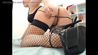 A sexy teasing in fishnet stockings, heels, fingering