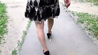 Crossdresser in stockings goes out for a walk with camera