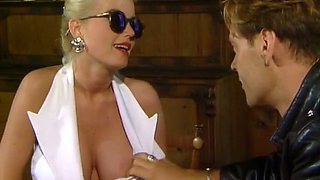 Sassy and hot blonde bimbo with big breasts is good at oral sex