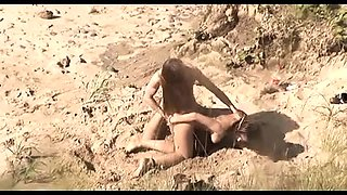 Passionate young lovers having fun on the beach