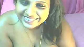 Indian auntie on webcam teases me with her big titties