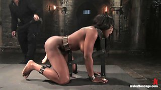 Ebony whore gets her big titties tied up with rope in bondage scene