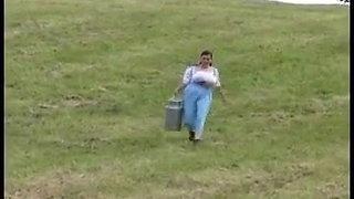 Milena milks herself at a farm