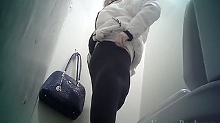 Hot young blonde girl shows her ass on spycam nude in the toilet