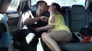 Cutie picked up to suck a big black cock in the car