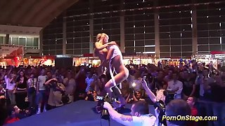 extreme hot babes in sexy babes uniform kissing and licking on public sexfair show stage