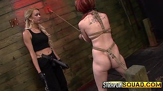 Redhead Slave Is Whipped By Strap On Dommes