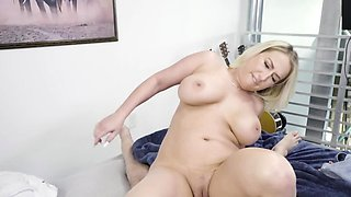 Buxom blonde is bouncing her big curves on a hard prick
