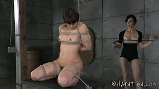 Slave girl with puffy nipples is restrained by her gorgeous dominatrix