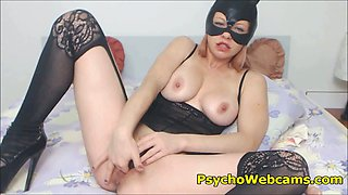Cat Woman with Mask in Stockings and High Heels Toying