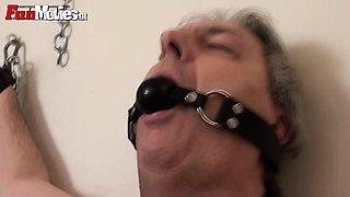 Dominatrix fucks slave with a strap on