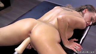 Oiled slut taking fucking machine
