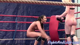 Roundass lesbians wrestling in a boxing ring