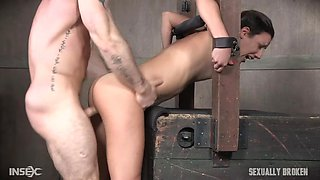 naughty sex slave gets fucked from behind in stocks