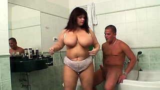 Busty mom and son-in-law fucking in the bathroom