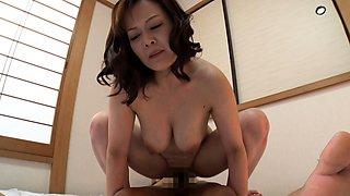 Busty Asian MILF enjoys a big milky pecker